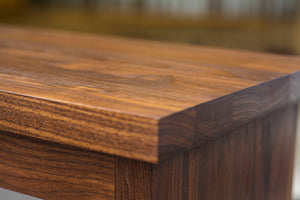 close up view of dark wood bench