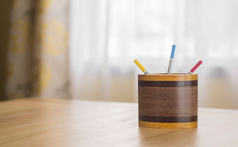 oval wooden pencil holder cup in walnut on desk