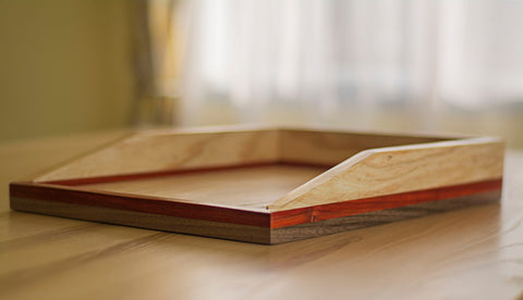 light wood paper tray on desk