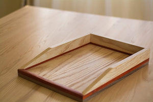 single tray light wood paper tray on desk