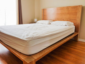 simple cherry wood bed frame with head board and platform