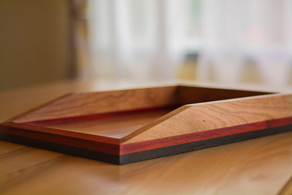 wooden paper tray sitting on desk