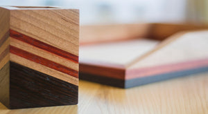 red striped wooden desk tray on desk
