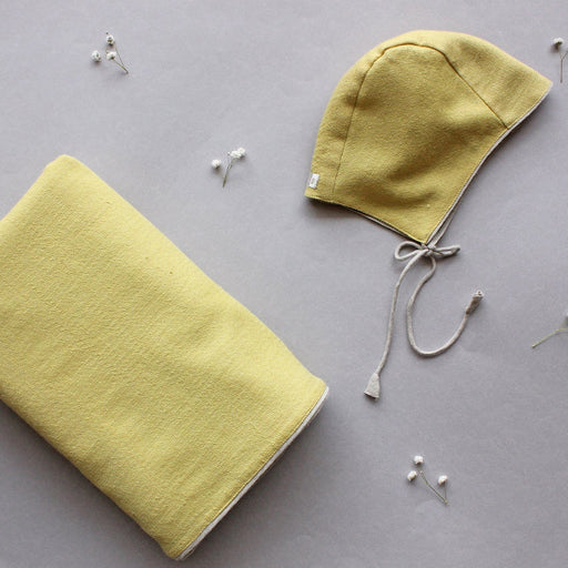 The Nestery brings khadi-lined pure merino wool blanket in soothing herbal colours with an equally soft, warm baby wool cap for newborns.