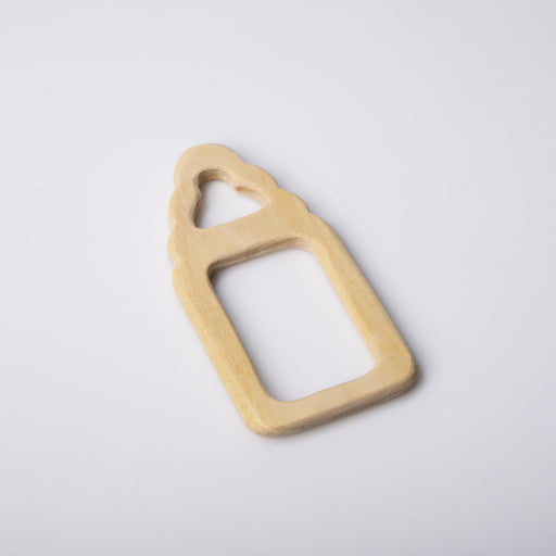The Nestery: Montessori Toy - Ariro - Neem Wood Teether – Milk Bottle