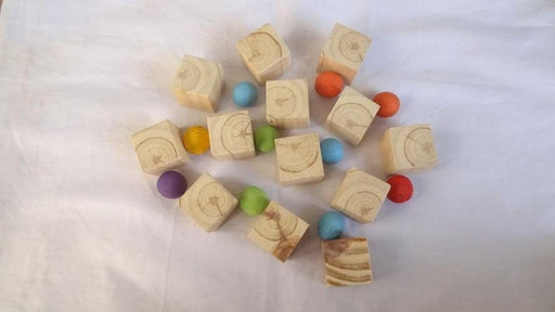 The Nestery curates online wooden cubes for infants+ that are building toys made in India. This is a 10 piece wooden cube set with natural finish. These are waldorf toys in India.