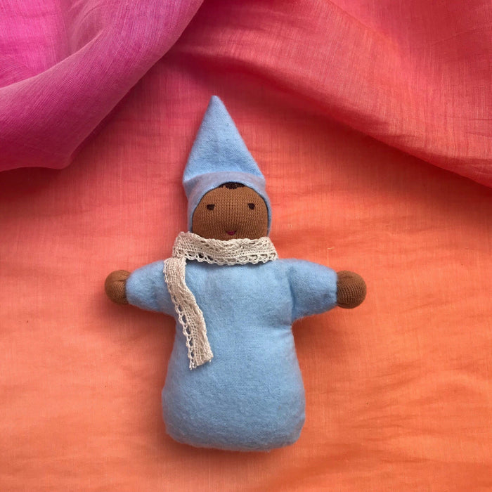 This image shows a blue doll with a brown face. Doll kits made for Indian children by an Indian mother and teacher.mom