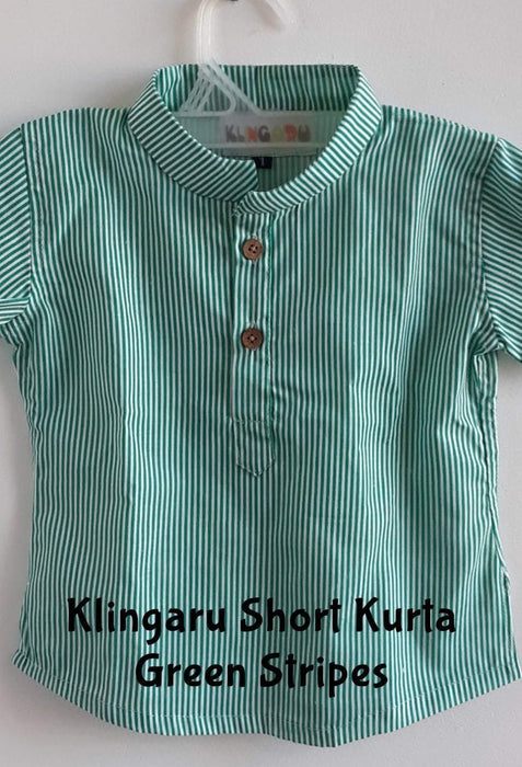 A green short shirt/kurta with linear stripes is hanging on a hanger