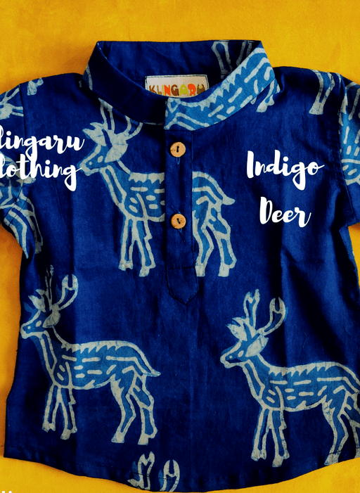 A little boy wearing an indigo blue kurta with deer motifs