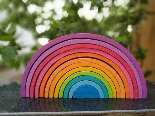 The Nestery curates online rainbow stacker toys for 3+ year olds that are waldorf toys made in India. This is a 12 piece rainbow stacker set with purple-hued finish. These are waldorf toys in India.