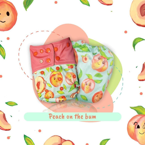 The Nestery: A Toddler Thing - Newborn Cover Diaper - Peach On The Bum