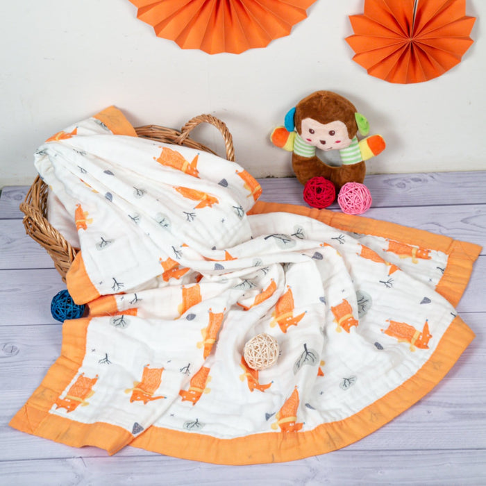 The Nestery : Baby Moo - Animal Print White And Orange - Muslin Blanket