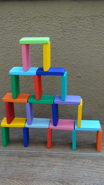 The Nestery curates online open ended toys for 3+ year olds. This is a wooden Dominoes set with natural wooden finish.
