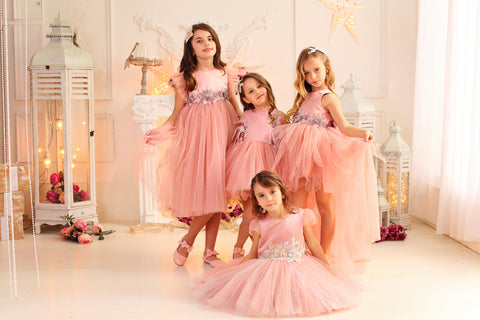 little girls in pastel pink dresses