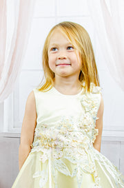 handmade short yellow flower girl's dress with an A-line tulle skirt and pastel color floral embroidery