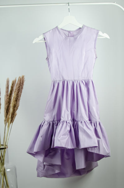 unique, handmade, asymmetrical girl dress in a lavender purple color with a midi-length ruffled skirt
