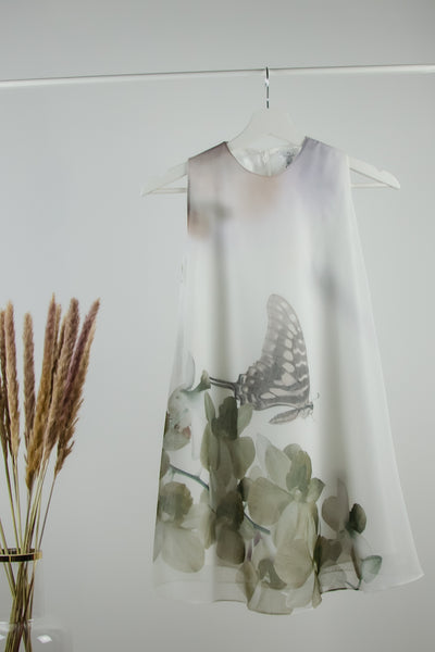 handmade boho style flower girl dress in white with a gray butterfly and floral pattern, elegant party dress for girls