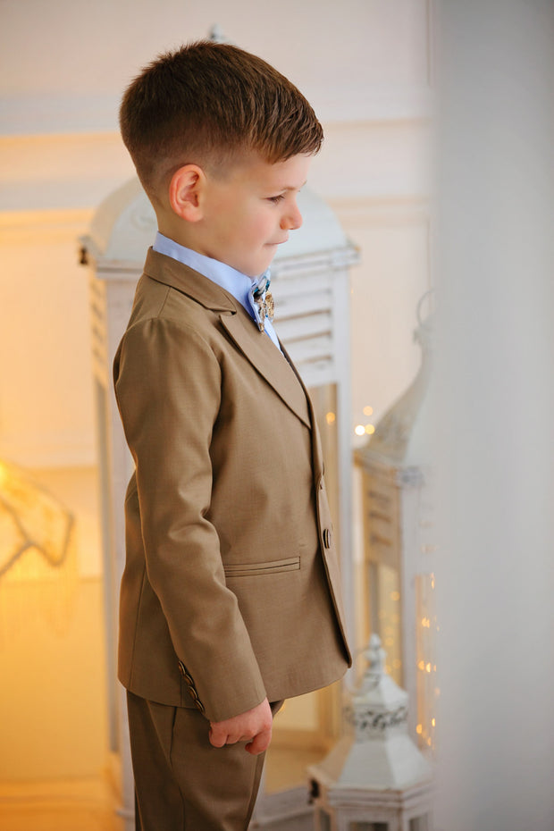 handmade elegant brown ring bearer suit for boys with double buttons, blue shirt and a brown bow tie