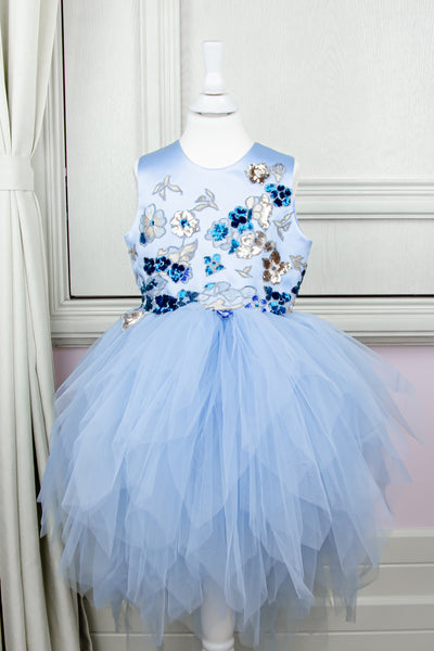 custom made personalised girl dress in baby blue with an asymmetrical tulle skirt and gold and blue sequins in birds and flowers pattern