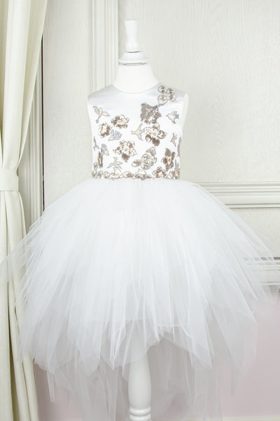 custom made personalised girl dress with an asymmetrical white tulle skirt and gold sequin embroidery in flower and birds pattern