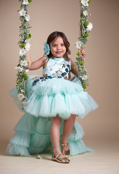 custom made personalised girl tulle dress with high-low hemline, mint tulle skirt and gold and blue sequin embellishments
