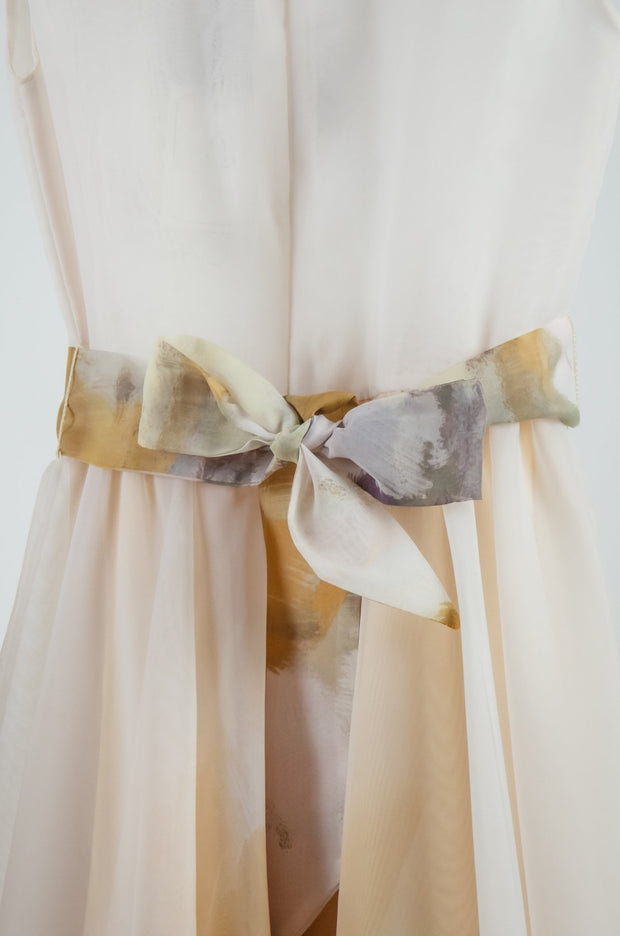 Unique, handmade, simple and elegant flower girls dress for special occasions in white, beige, brown with a tulle skirt, ribbon at the waist and 3D floral embellishment