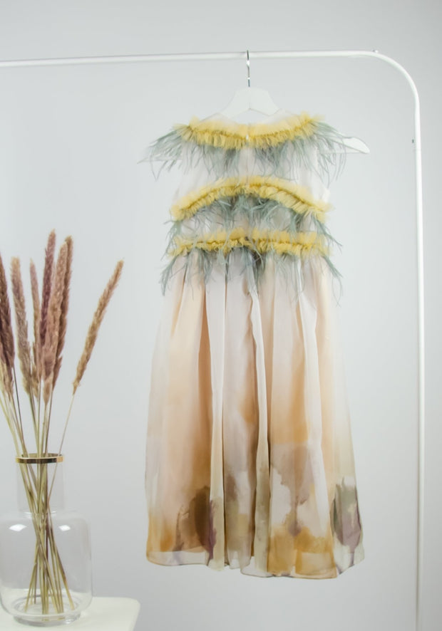 unique, handmade, midi fancy girl party dress for special occasions with a tulle skirt and yellow and gray feather embellishments