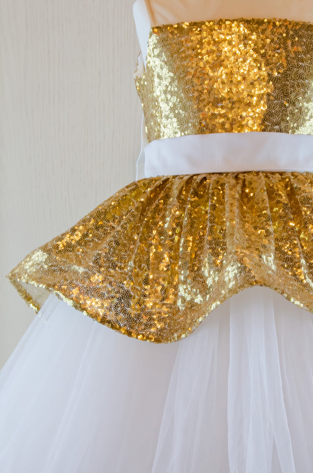 handmade, festive girl party dress with a white tulle skirt, golden sequin top and a big white bow at the back, for special occasions