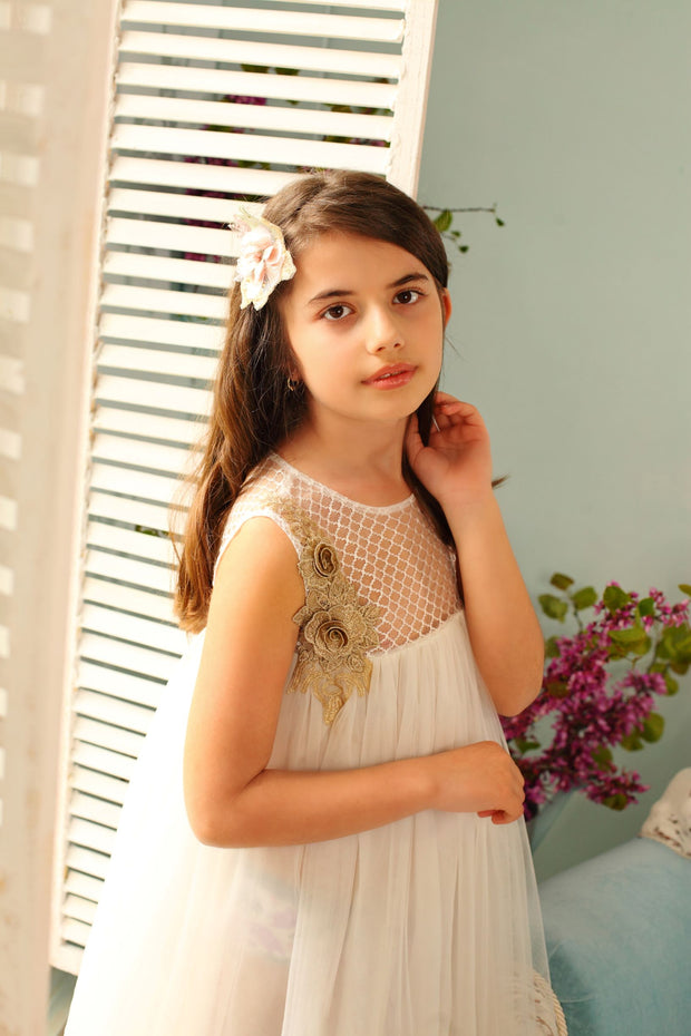 white flower girl dress decorated with floral embellishment