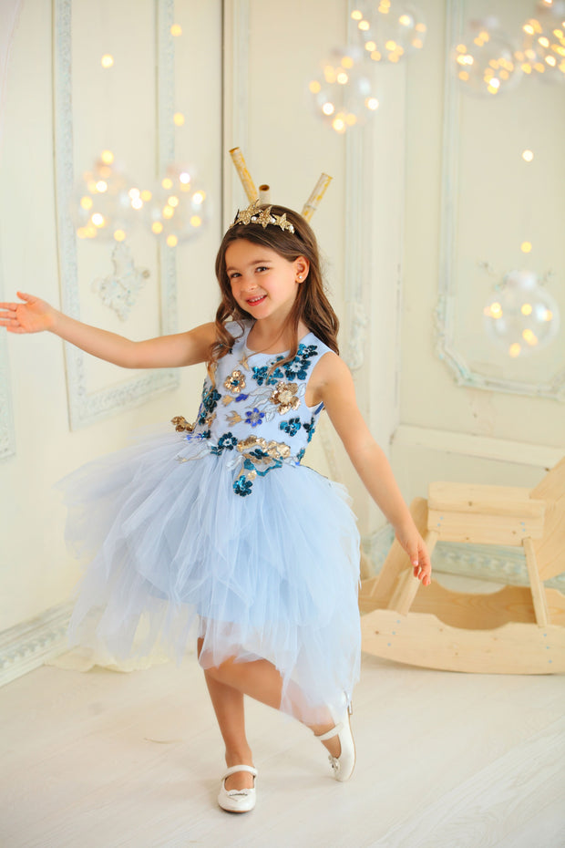 blue little girl dress with knee-length tulle skirt and satin upper part decorated by floral embellishment