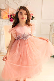 pastel pink girl dress with multi-layer tulle skirt and floral embellishment for parties and special occasions