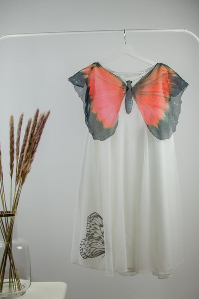 unique, handmade white girl party dress for special occasions in boho style with a large red butterfly pattern