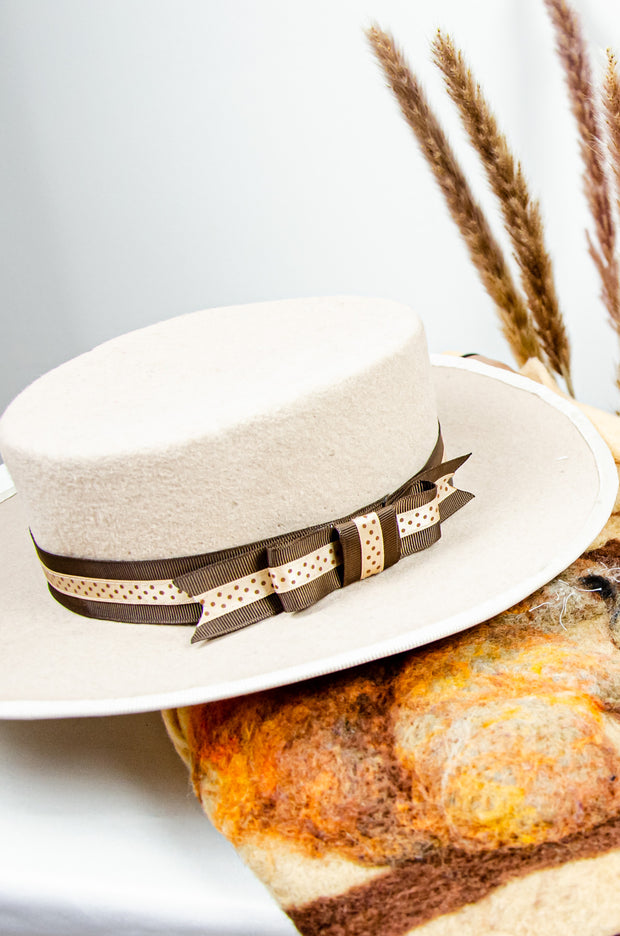 handmade beige felt hat for girls with a brown and beige ribbon