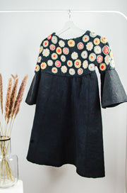 Unique handmade black felt fall coat for girls with ruffled sleeves and hand embroidered circle and floral motifs