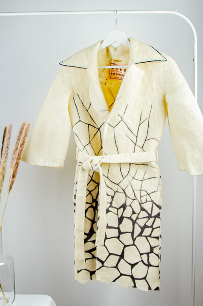 Unique handmade long beige felt fall coat for girls with a black pattern and a belt at the waist