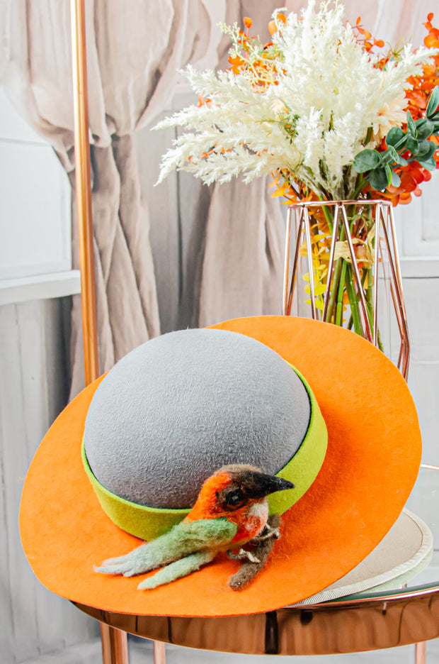 handmade orange and grey felt hat for girls with a 3D felt bird motif
