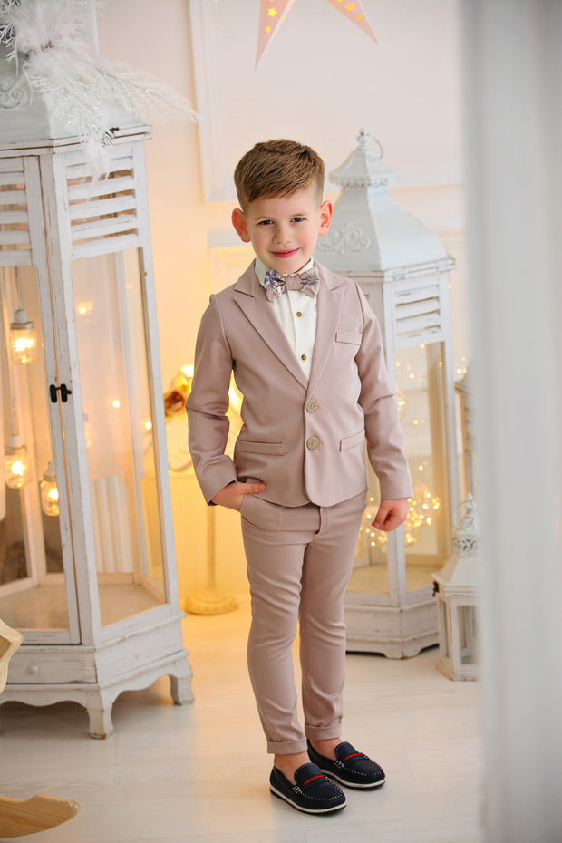 Handmade beige ring bearer boy suit with a beige bow tie and a white shirt