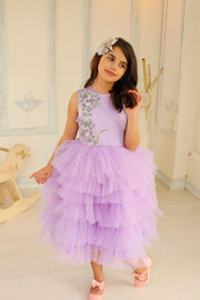 little girl dresses up in purple dress for special occasion