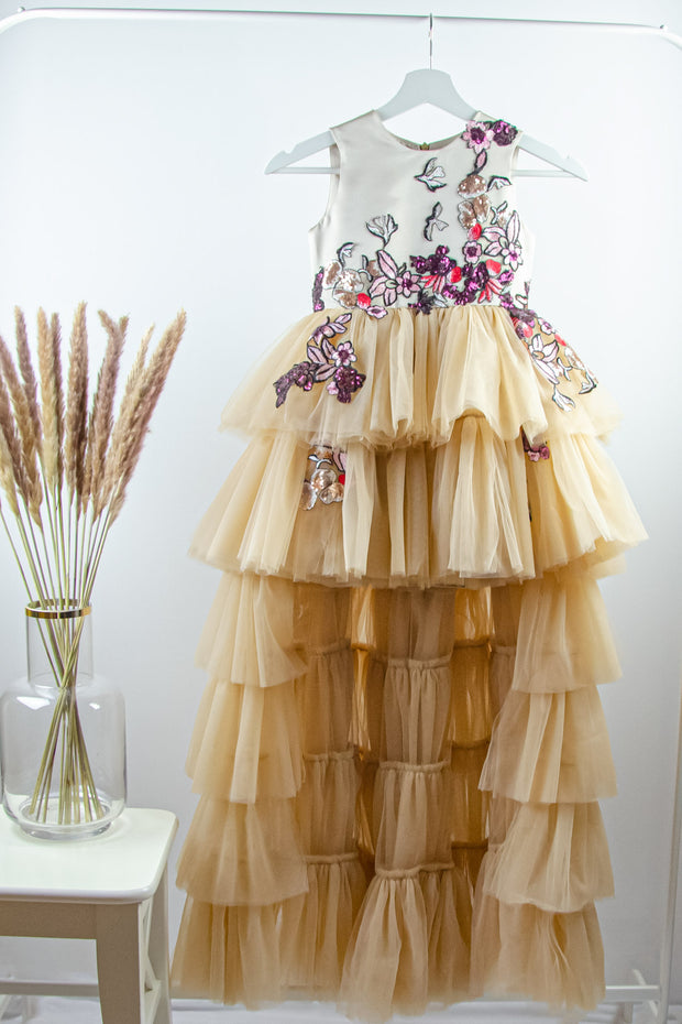 handmade long beige princess girl dress with a multi-layered asymmetrical tulle skirt and pink and red embroidery and sequins