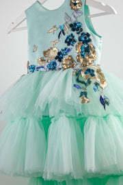 handmade long multi-layered princess tulle dress in mint with gold and blue floral embroidery and sequins, for flower girls, birthdays and weddings