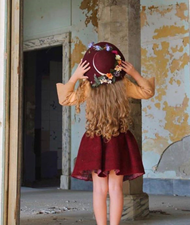 handmade burgundy felt hat for girls with floral embellishment and a beige ribbon