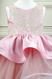 Handmade asymmetrical pink flower girl dress with multi-layer tulle skirt, satin overlay, satin train and gold lace embroidery, for flower girls, weddings, birthdays.