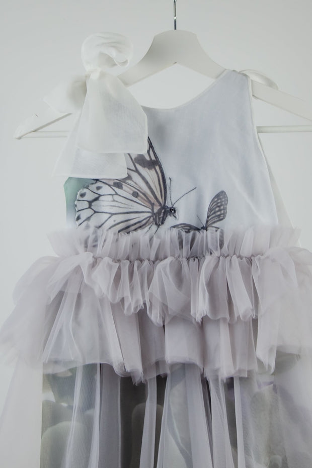 unique, handmade, short white and gray flower girl dress with a tulle skirt, gathered waistline and a butterfly pattern on the top
