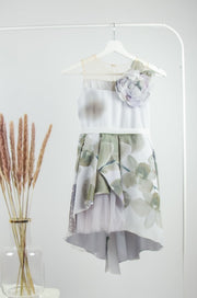 handmade, asymmetrical white and gray baby girl dress for flower girls, weddings, communion, patterned tulle skirt, ribbon at the waistline and a 3D flower on the top