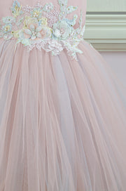 pastel pink little girl dress with multi-layer tulle skirt and floral embellishment for birthday parties and special occasions