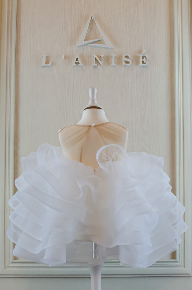 handmade short white princess tulle girl dress with a multi-layered tulle skirt, transparent top and 3D butterfly embroidery. The dress is perfect for flower girl dress, wedding guest outfit, communion or birthday party.
