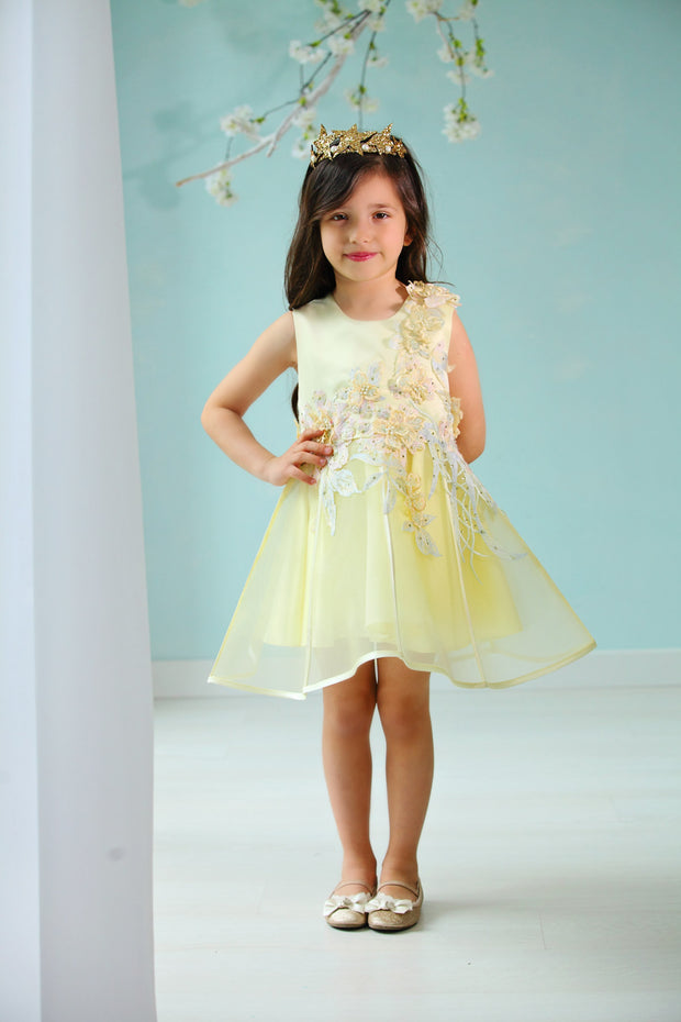 handmade short A-line yellow flower girl dress with a short tulle skirt and hand embroidered top with pastel flowers, pearls and rhinestones