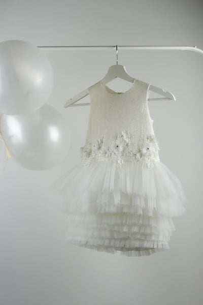 handmade, white tulle baby girl party dress for special occasions, with a short multi-layered tulle skirt and white lace and flower embellishments, for flower girls, communion, weddings, birthday party
