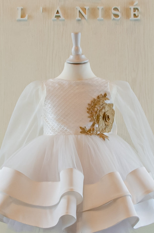 Handmade short white flower girl's dress with a multi-layered tutu skirt, golden embroidery and a big bow on the back