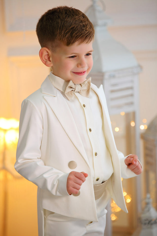 handmade white ring bearer tuxedo suit for boys with a white shirt and a beige bow tie